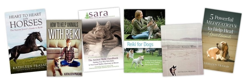 side by side books on animal reiki written by kathleen prasad