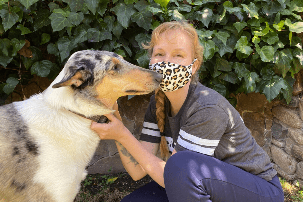 Kathleen Prasad wearing a face mask with her dog vincent