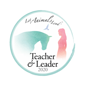 a badge indicating a let animals lead® teacher or leader