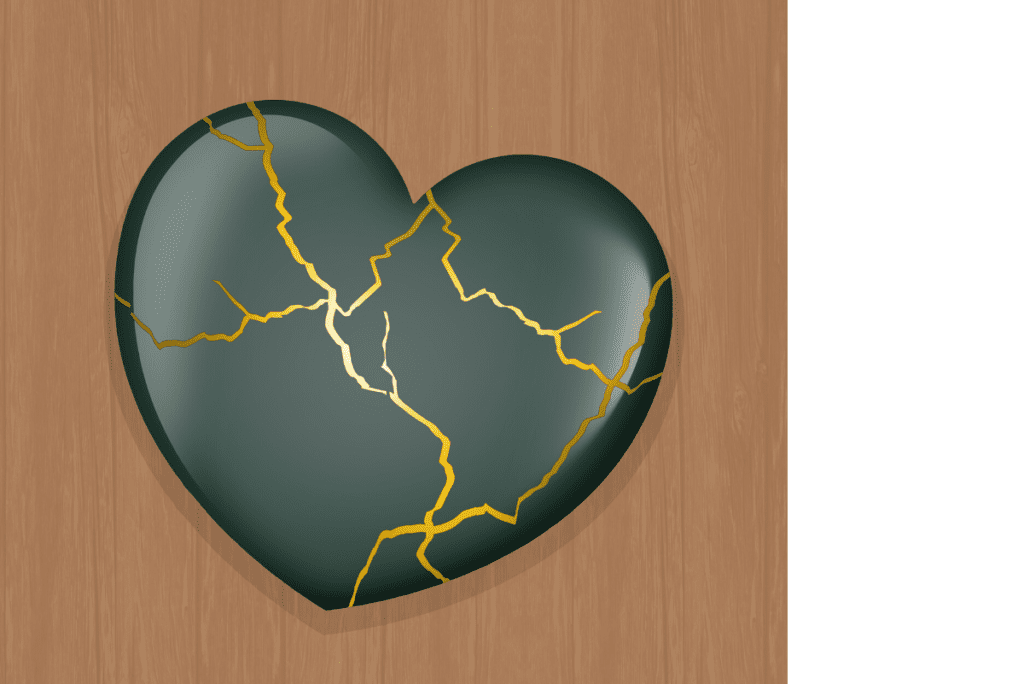A ceramic heart fixed by Kintsugi, the japanese art of fixing cracks with gold