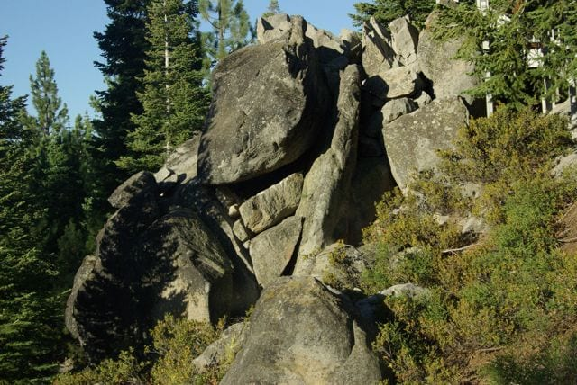 a rocky crag in the side of a mountain
